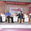 Madhur Bhandarkar interacting with the host at Aaj Tak Panchayat Talk Show
