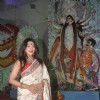 Rituparna poses for the media at DN Nagar Durga Pooja