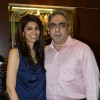 Zeba Kohli poses with her husband at the Project Seven Preview