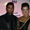 Sachin Joshi poses with wife Urvashi Sharma at the Launch of Planet Hollywood