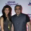 Zeba Kohli poses with her husband at the Launch of Planet Hollywood