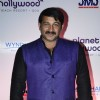 Manoj Tiwari poses for the media at the Launch of Planet Hollywood