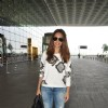 Esha Gupta poses for the media at Airport
