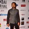 Rahul Bose poses for the media at the 16th MAMI Film Festival