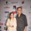 Vidhu Vinod Chopra poses with wife at the 16th MAMI Film Festival