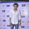 Divyendu Sharma poses for the media at the Brailler Menu Launch