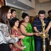 Tanishaa Mukerji and Rishi Kapoor light the lamp at a Special Art Show Preview