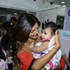 Sushmita Sen plays with a kid at Dr. Trasi's Clinic Launch
