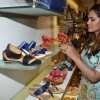 Esha Gupta checks out various varieties of sandals at Bata showroom