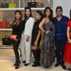 Celebs pose for the media at Michael Korrs Store Launch