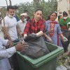 Tammanah unloads the garbage in a bin at a Cleanliness Drive