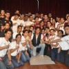 Shahrukh Khan poses with the staff at KidZania