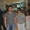 Aamir Khan and Kiran Rao snapped at airport while returning from Arpita Khan's Wedding