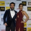 Saif Ali Khan and Ileana D'Cruz pose for the media at the Premier of Happy Ending in Delhi