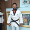 Ajay Devgn poses for the media at Taekwondo Felicitation Event