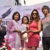 Bipasha Basu felicitates an achiever at the Launch of the 3rd Edition of Pinkathon