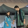 Viraf Phiroz Patel walks the ramp with a small girl at Wellingkar's 26/11 Tribute