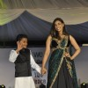 Lisa Ray walks the ramp with a small boy at Wellingkar's 26/11 Tribute