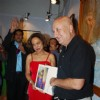 Anupam Kher poses with a potrait at the Inauguration of India Art Festival