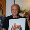 Anupam Kher poses with the potrait of Mother Teresa at the Inauguration of India Art Festival