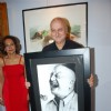 Anupam Kher poses with his potrait at the Inauguration of India Art Festival