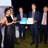 Sophie Choudry cuts the cake at the British Airways Bash