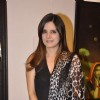 Simone Khan poses for the media at Camel Colors Exhibition