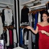 Elli Avram points out at the designs at the bebe Store