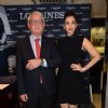 Aishwarya Rai Bachchan poses with an official at the Launch of Longines Store