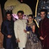 Manish and Punit Malhotra pose with the newly wedded couple Riddhi Malhotra and Tejas Talwalkar
