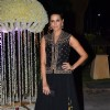 Neha Dhupia poses for the media at the Wedding Reception of Riddhi Malhotra and Tejas Talwalkar