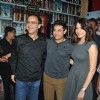 Vidhu Vinod Chopra, Aamir Khan and Anushka Sharma pose for the media at the Special Screening of P.K