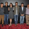 Team poses for the media at the Special Screening of P.K. for the Cast and Crew