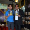 Ayan Mukerji poses with a guest at the Book Launch of 'The True Story of Sun Burn'