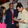 Aamir Khan signs an autograph for a fan at P.K. Contest Winners Meet