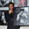 Shah Rukh Khan poses with his photo at Dabboo Ratnani's Calendar Launch