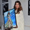 Bipasha Basu poses with her photo at Dabboo Ratnani's Calendar Launch
