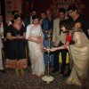 Varsha Usgaonkar lights the lamp at Golden Achiever Awards