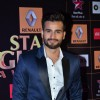 Karan Tacker poses for the media at Star Guild Awards