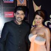 Gurmeet Choudhary and Debina Bonnerjee Choudhary pose for the media at Star Guild Awards