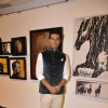 Randeep Hooda poses for the media at an Art Exhibition