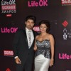 Gurmeet and Debina Choudhary pose for the media at 21st Annual Life OK Screen Awards Red Carpet