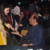 Aishwarya Rai Bachchan was snapped greeting Rajinikanth at the Music Launch of Shamitabh