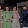 Family Members pose for the media at Soha Ali Khan and Kunal Khemu's Wedding Reception