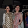 Karisma Kapoor and Kareena Kapoor pose at Soha Ali Khan and Kunal Khemu's Wedding Reception