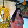 Alka Yagnik poses for the media at Bappi Lahiri's Saraswati Pooja