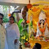 Asha Bhosle and Bappi Lahiri pose for the media at Saraswati Pooja
