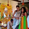 Kavita Kaushik and Sumona Chakravarti pose for the media at Bappi Lahiri's Saraswati Pooja
