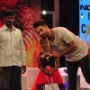 Shahid Kapoor poses with a child at NDTV Fortis Health 4U Cancerthon Campaign