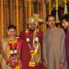 Uddhav Thackeray and Aditya Thackeray pose with the Wedding Couple Rahul and Aditi Thackeray